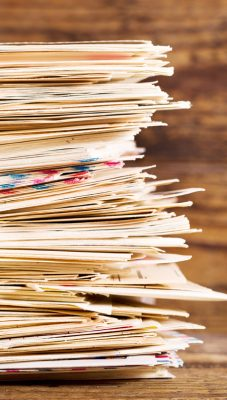 stack of envelopes on wooden background